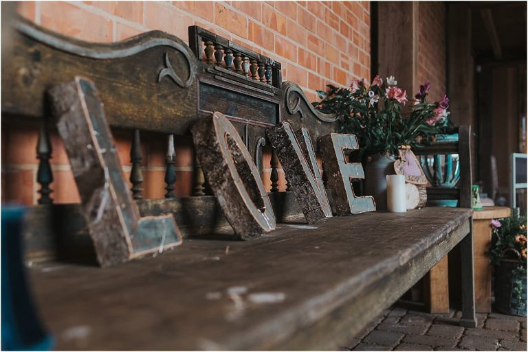 rustic bench with love letters and flowers on
