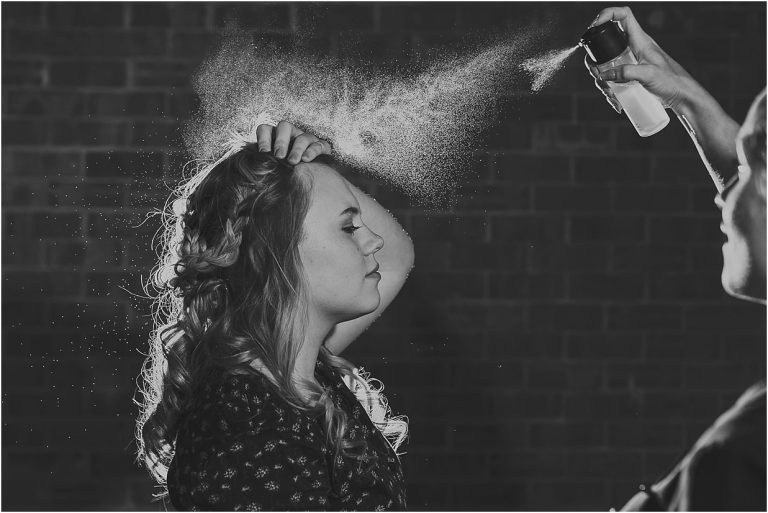 Northants wedding photographer black and white image of a lady having fixing spray put on her hair