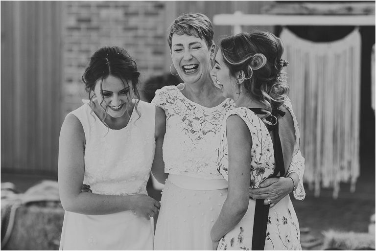 black and white image of three ladies laughing