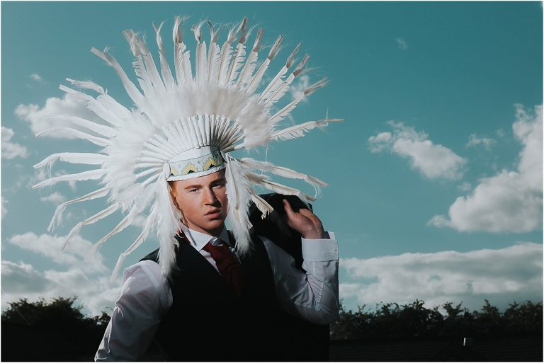 a man wearing a feather headdress
