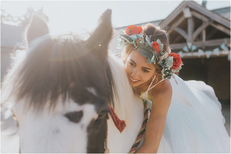 Northants wedding photographer a bride on a horse wearing a flower crown
