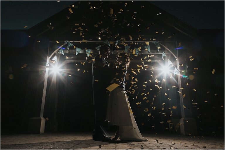 first dance shot with confetti flying, backlit by two speedlite flashes