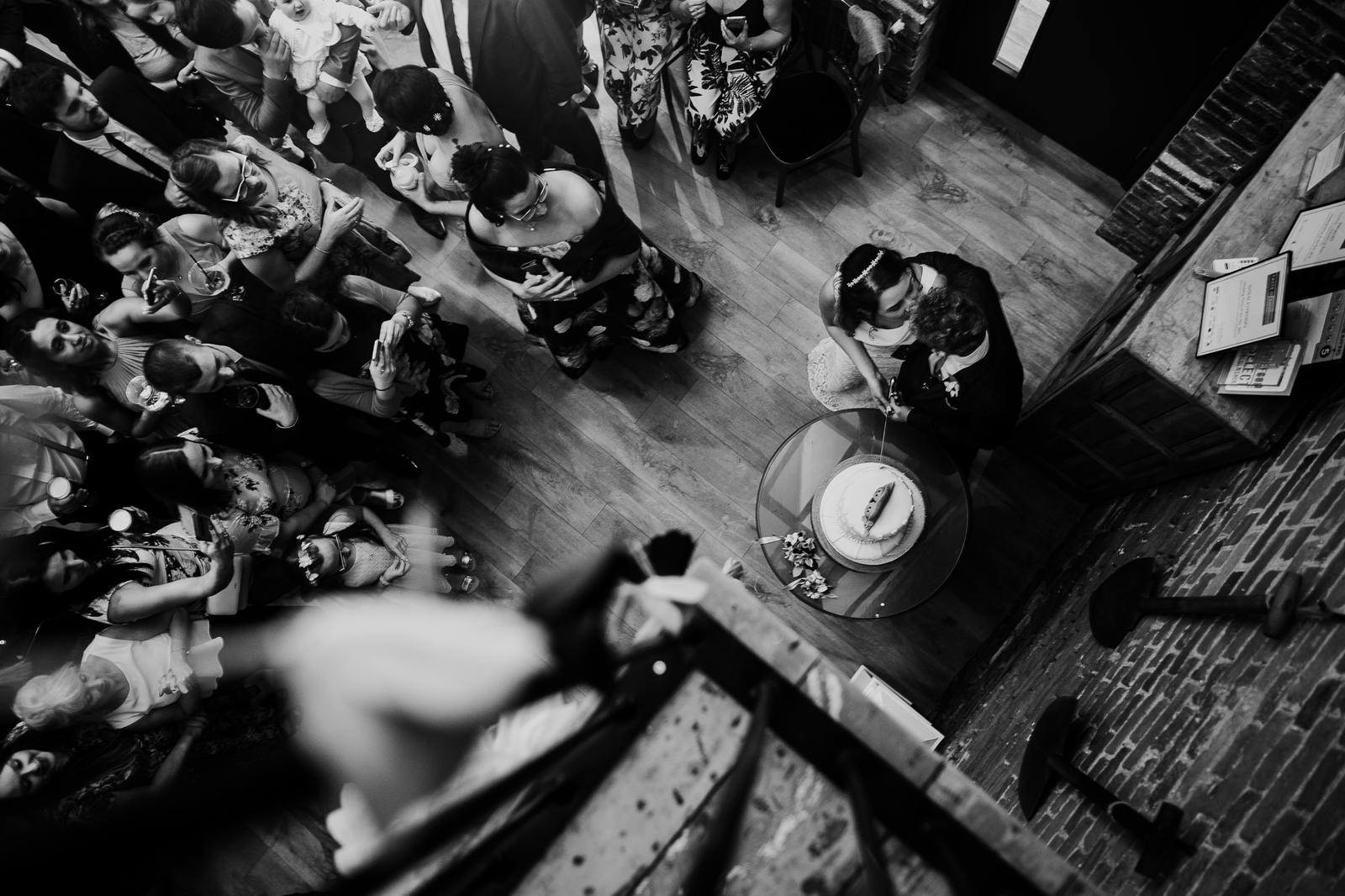 Documentary image of a cake cut at a wedding from above
