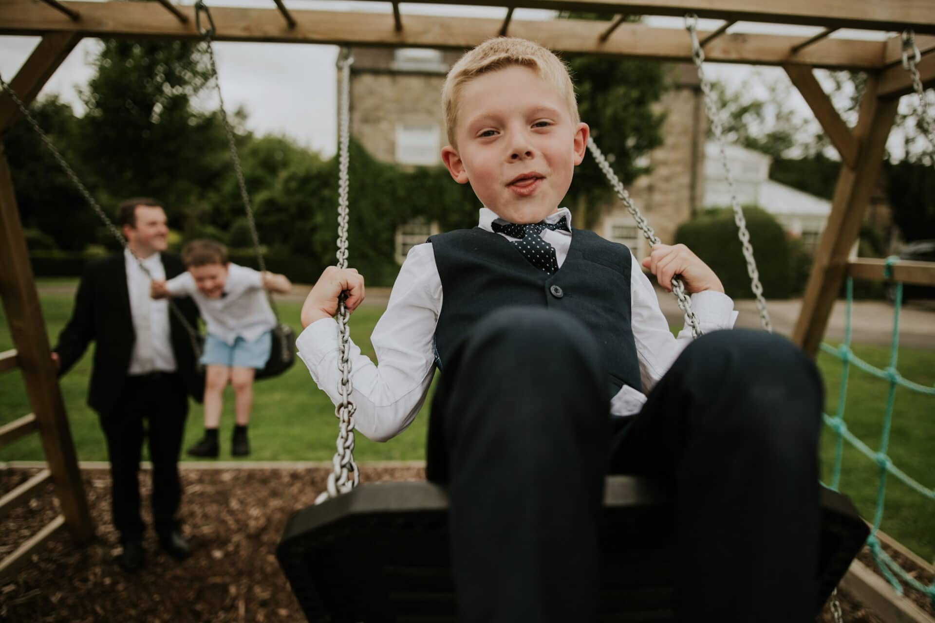 Barnsdale lodge, rutland, wedding guest on a swing