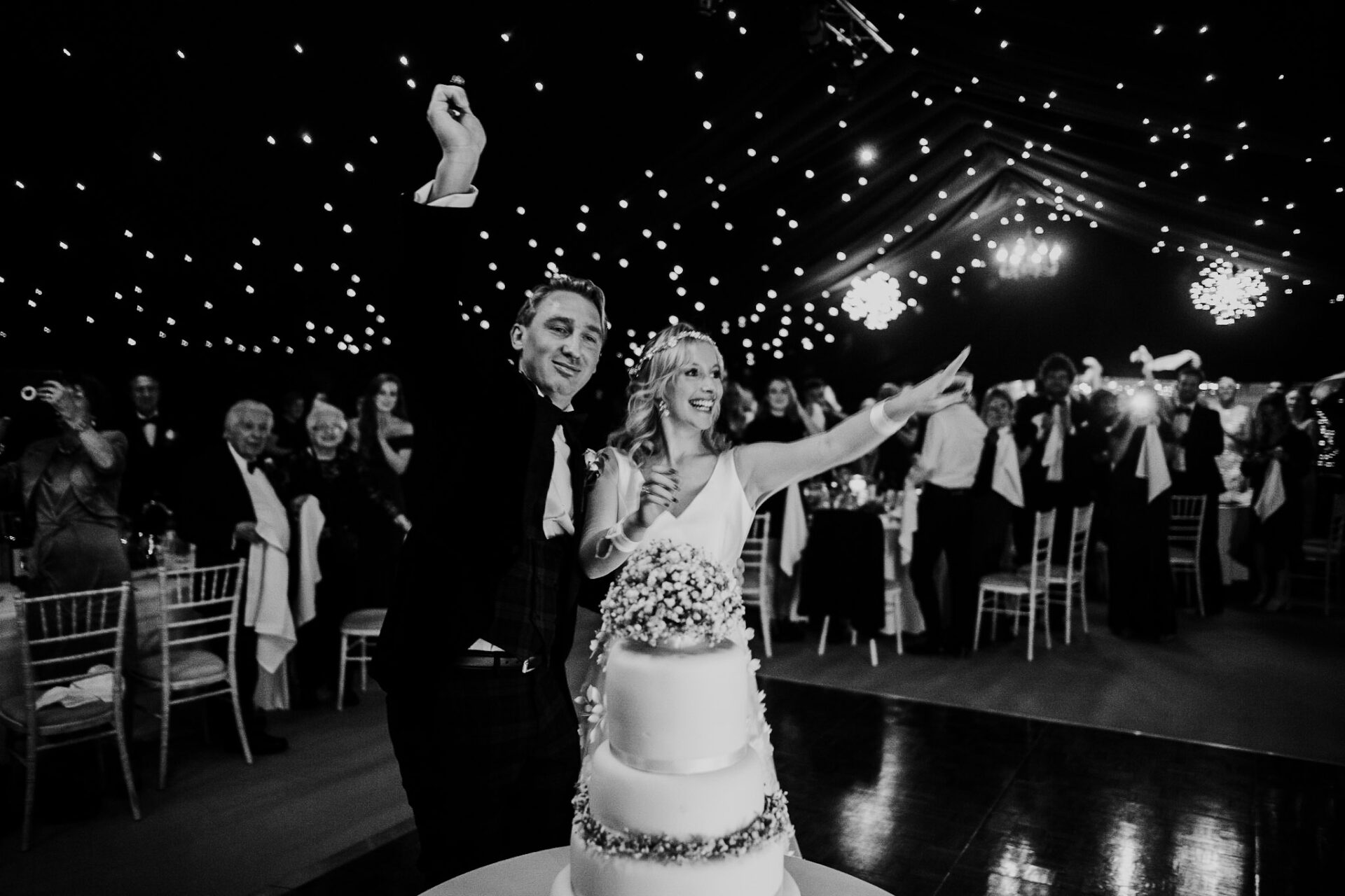 bride and groom cutting the cake photography