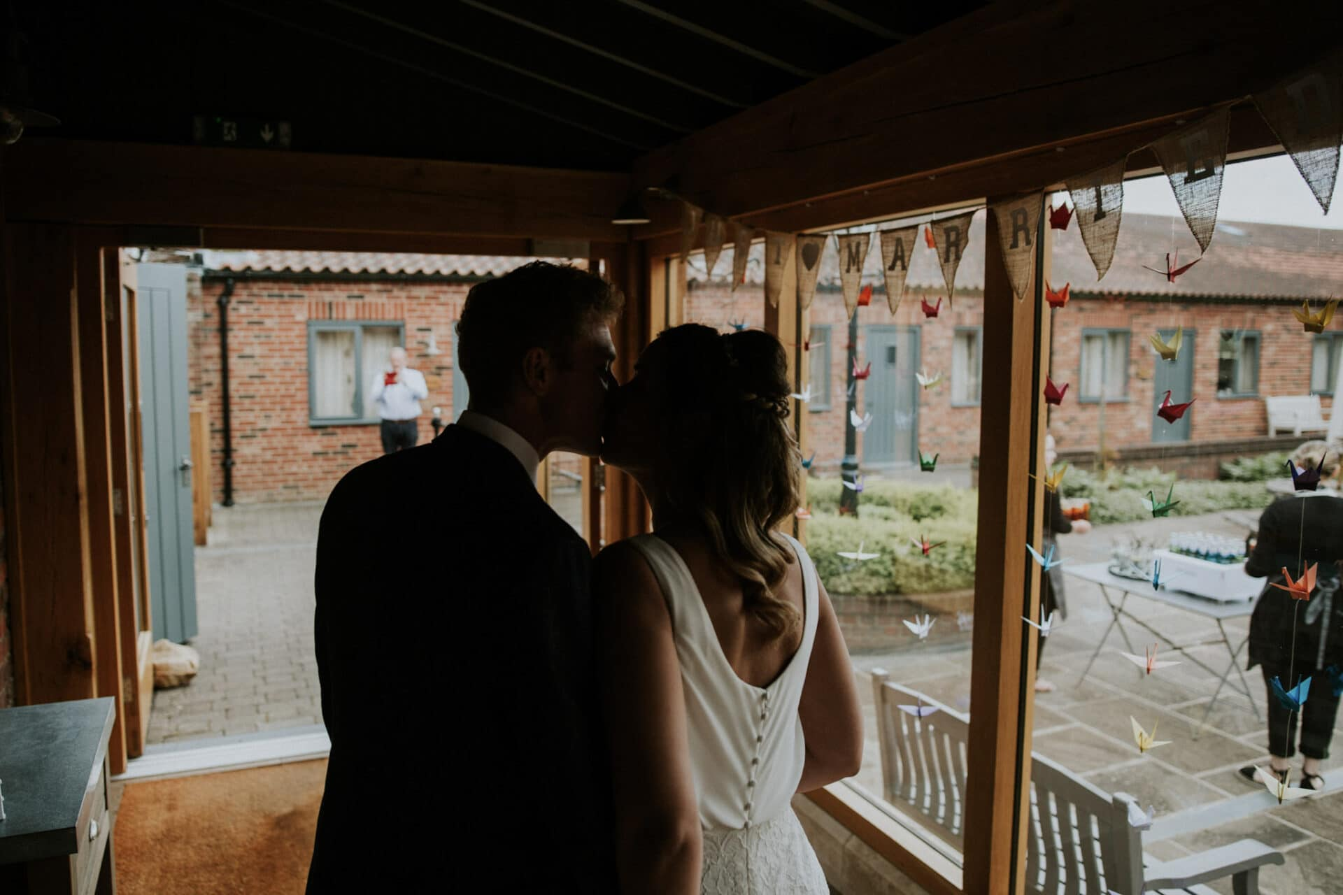 bride and groom kissing after their wedding reception photography