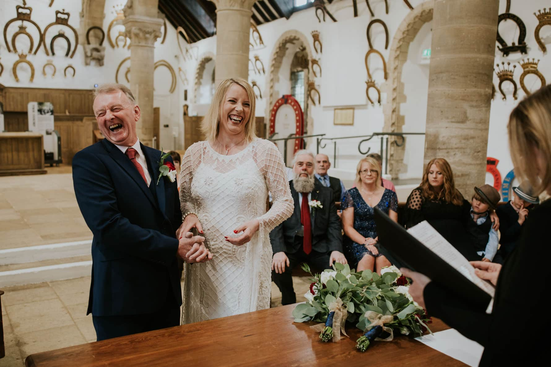 bride and groom laughing at oakham castle