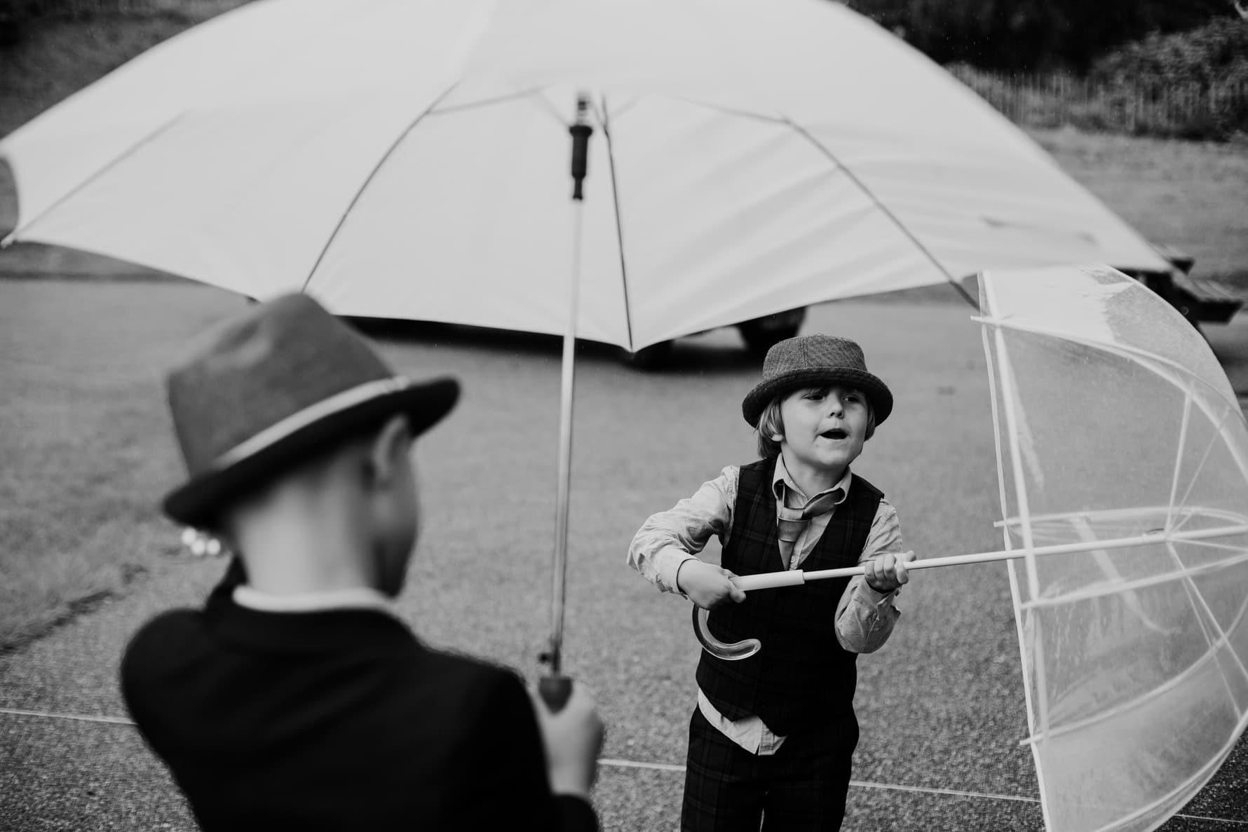 paige boy holding an umbrella