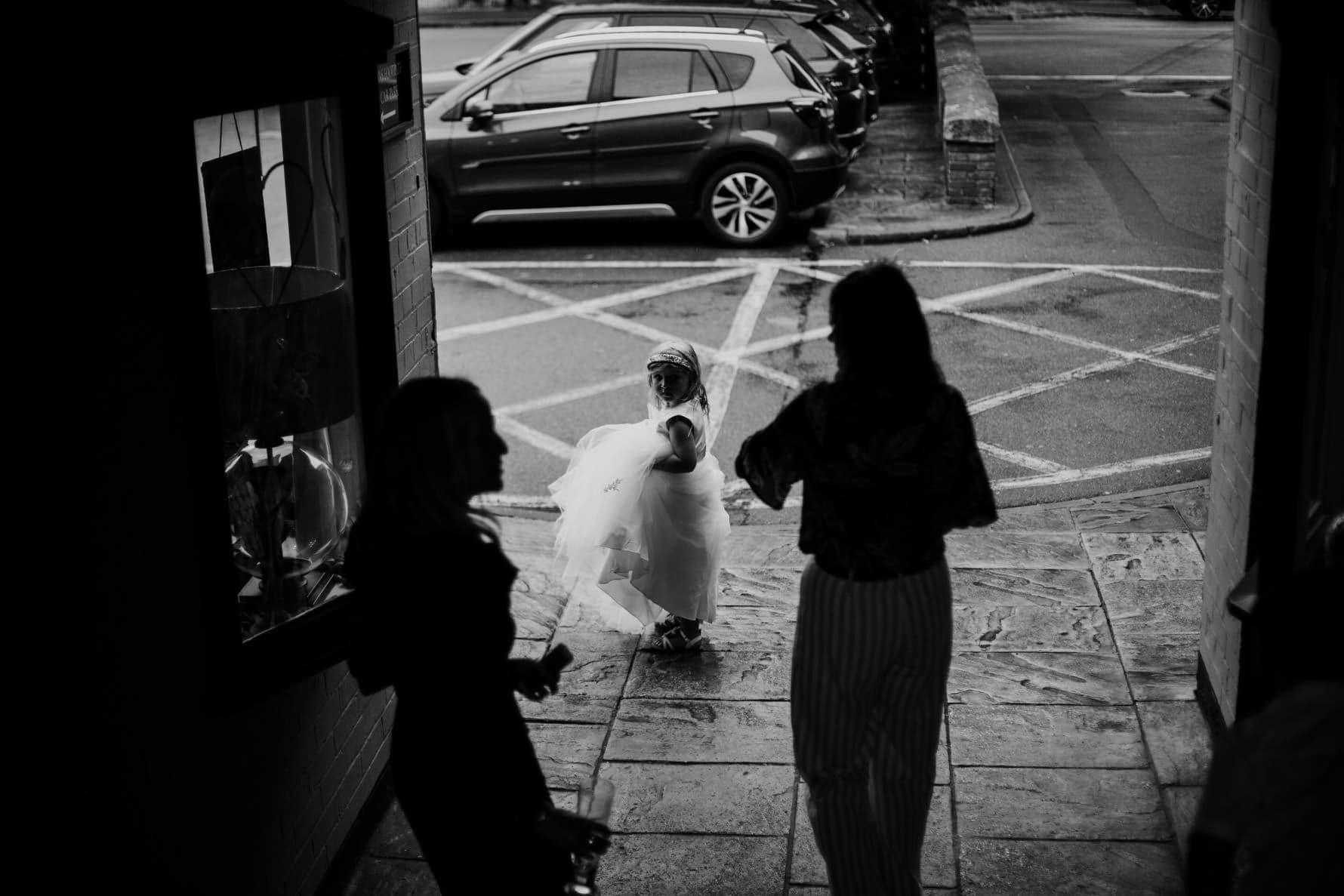 flower girl walking in the rain