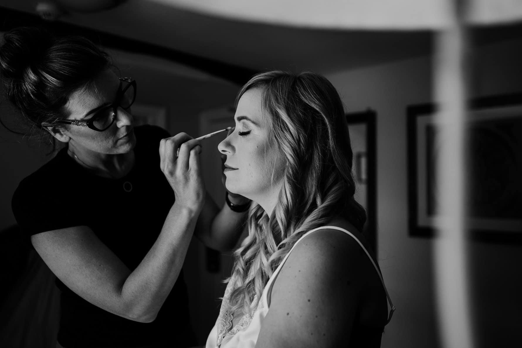bride having eye make-up applied