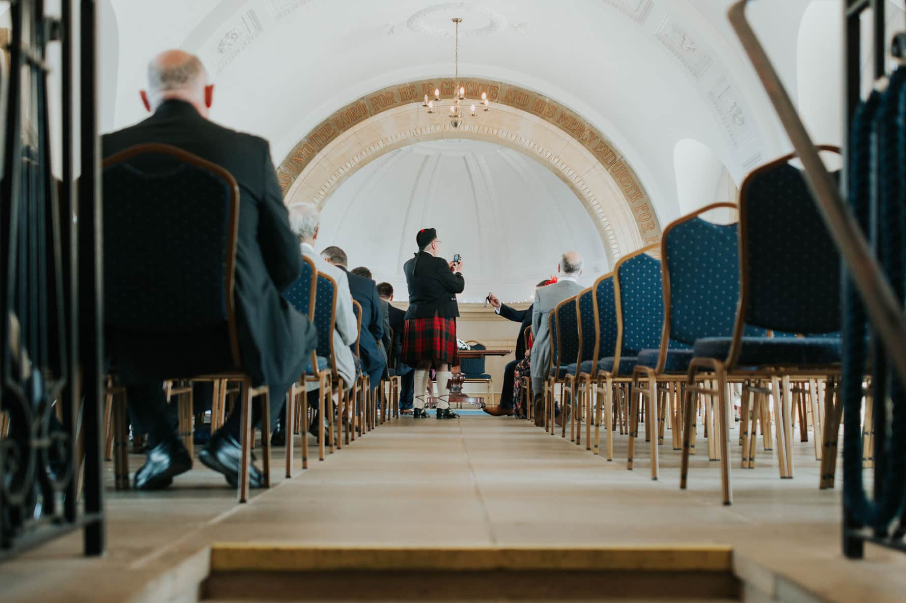 man in a kilt inside the church
