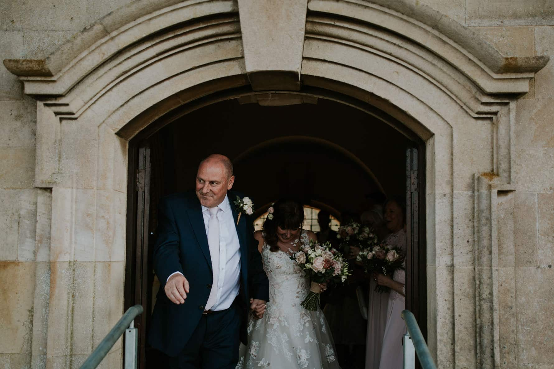 bride and groom leaving normanton church