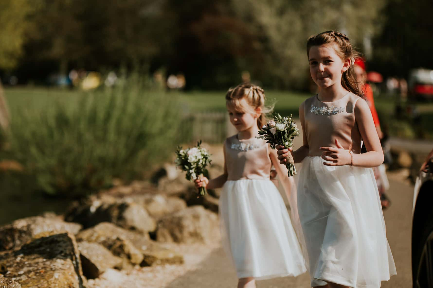 flower girls walking over to the wedding