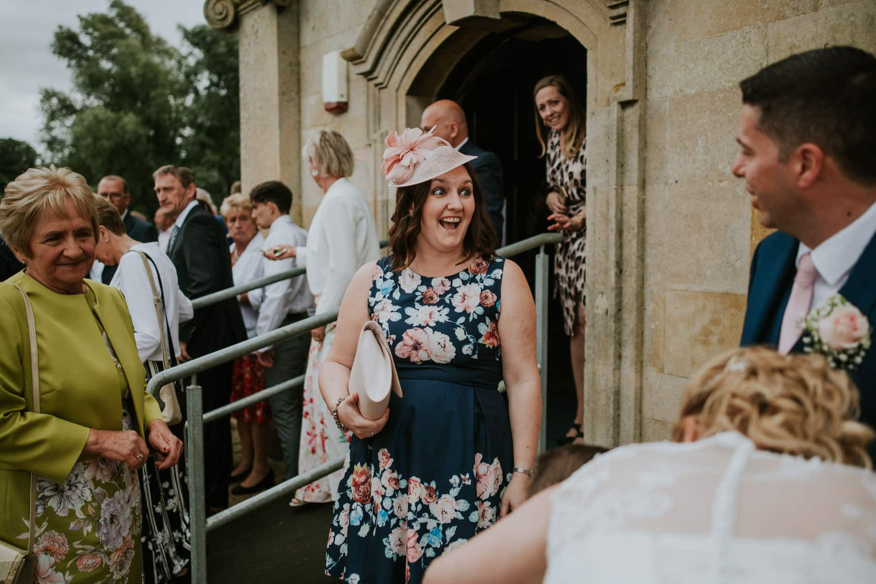 wedding guest at normanton church being hapy
