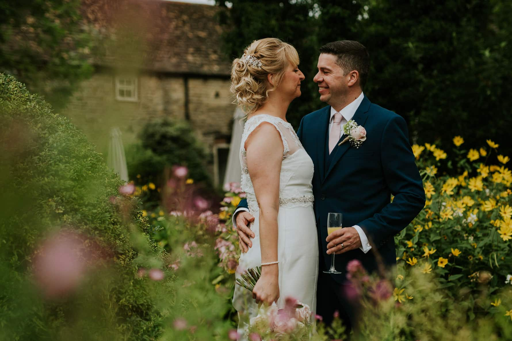 Bride and groom standing in Barnsdale lodge courtyard
