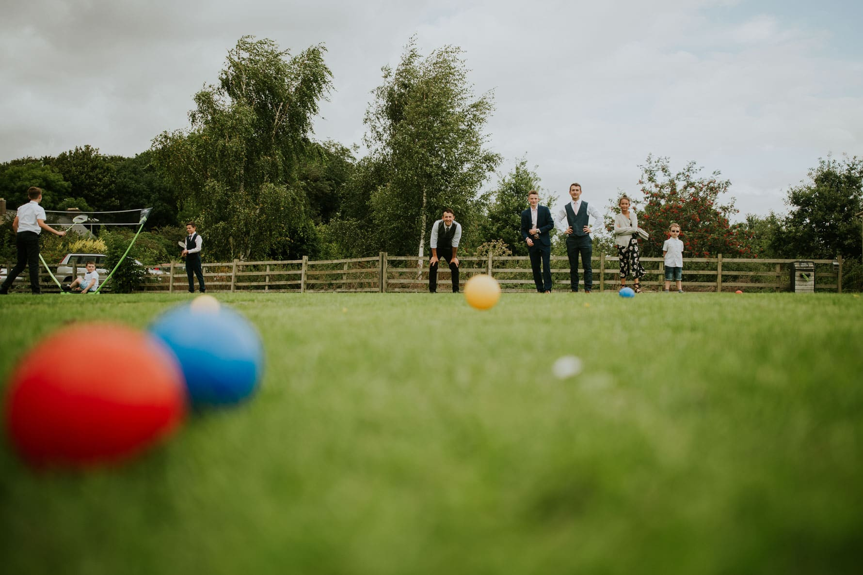 wedding guests playing boules outside barnsdale lodge