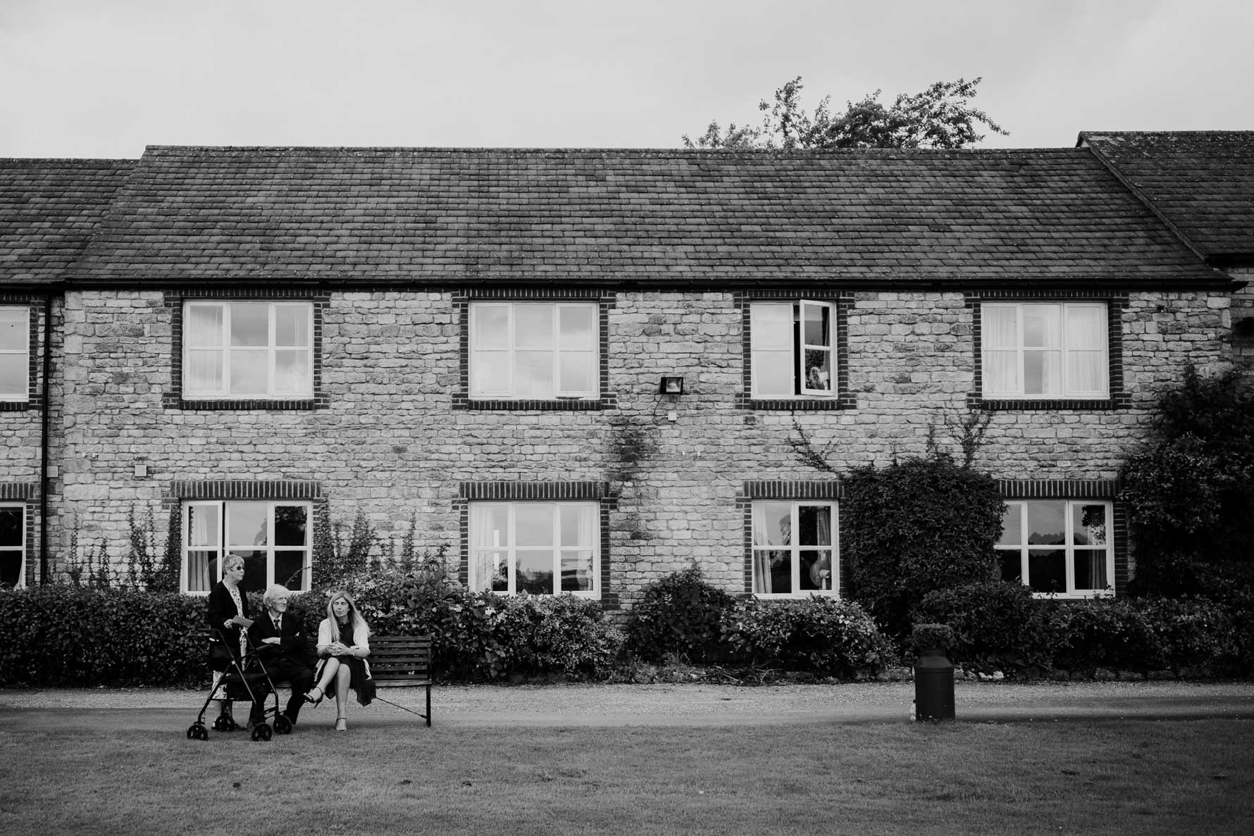 wedding guests relaxing outside barnsdale lodge