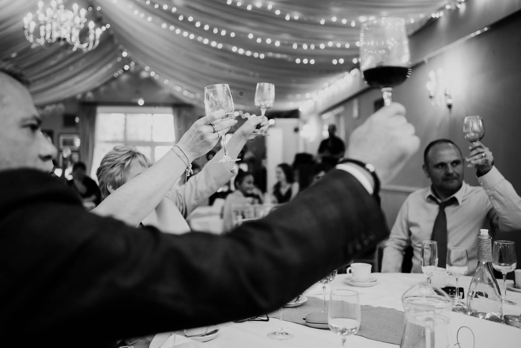 people toasting during a wedding speech - barnsdale lodge wedding photographer