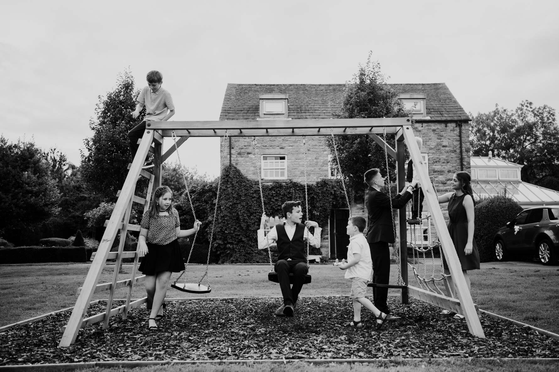 children playing on a swing at a wedding