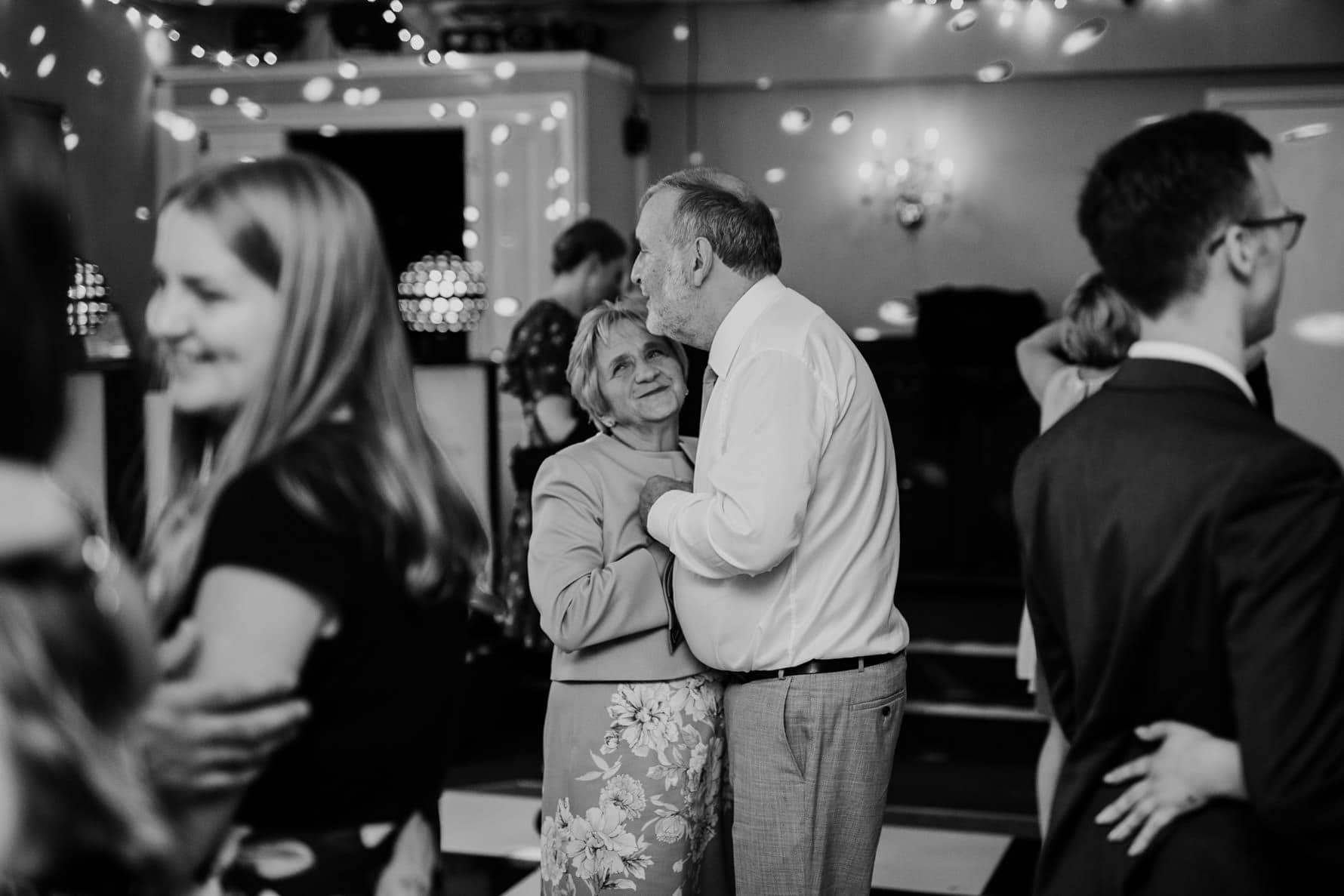 mother and father of the bride dancing at a wedding reception