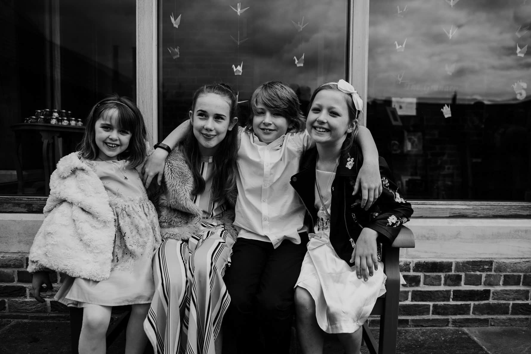 four children at a wedding