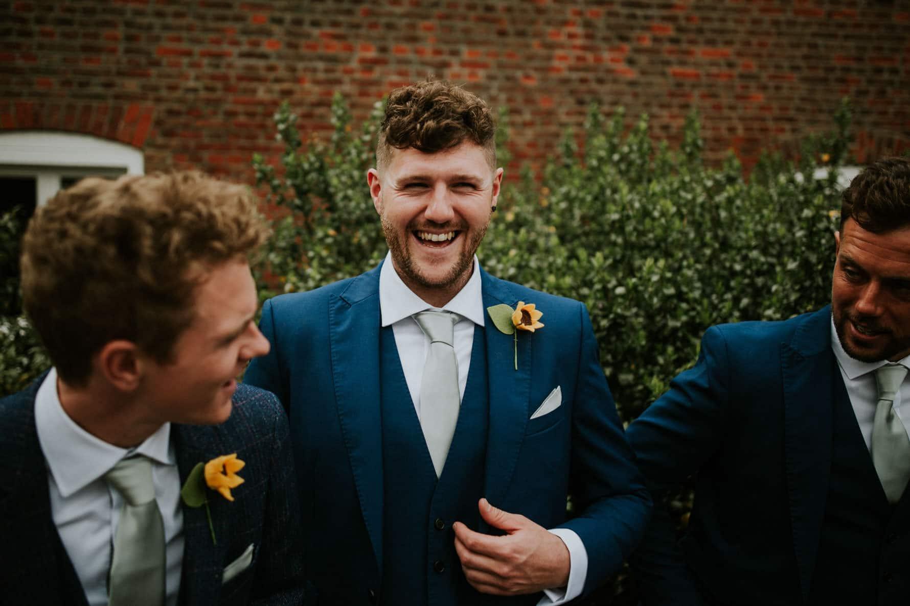 groomsmen laughing between each other