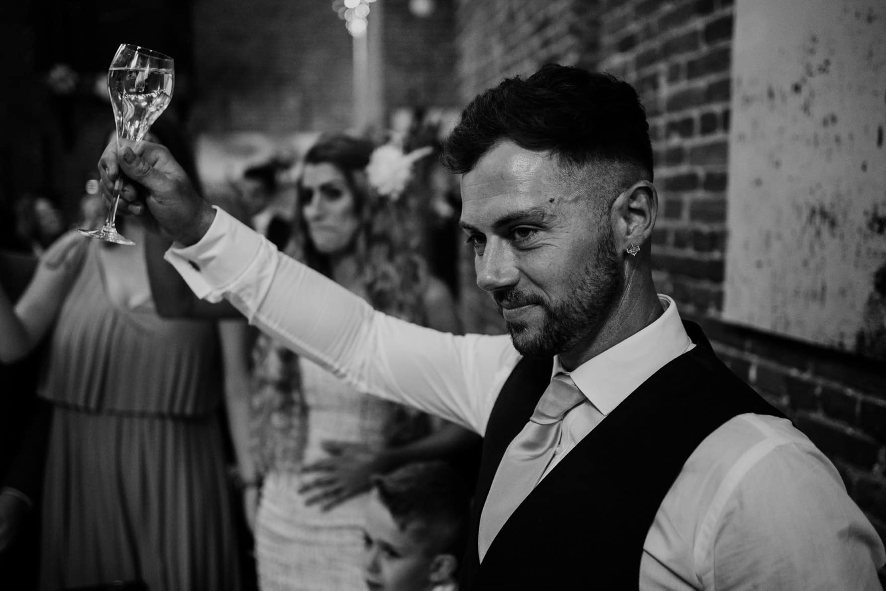 Wedding guest raising a toast during speeches
