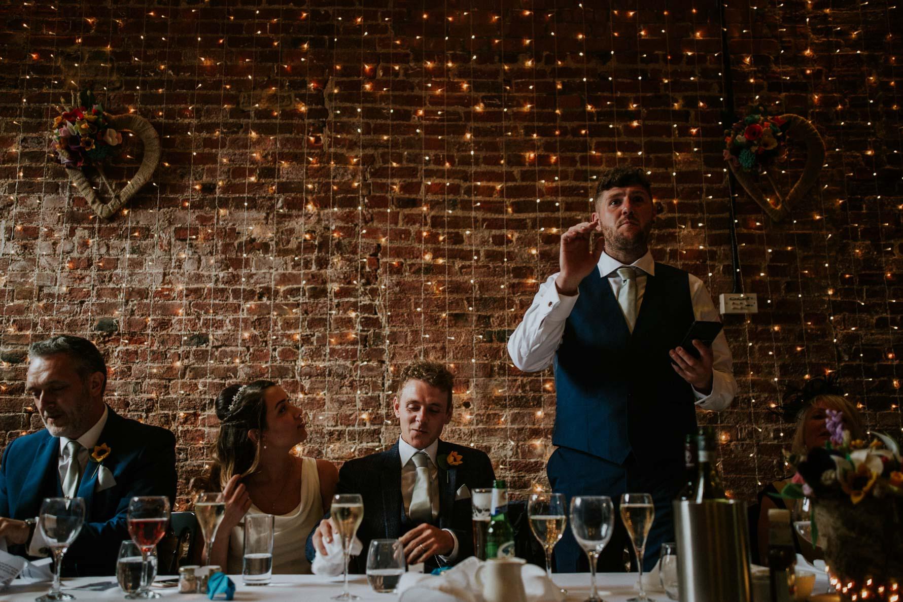 Best man giving a speech at granary wedding barn