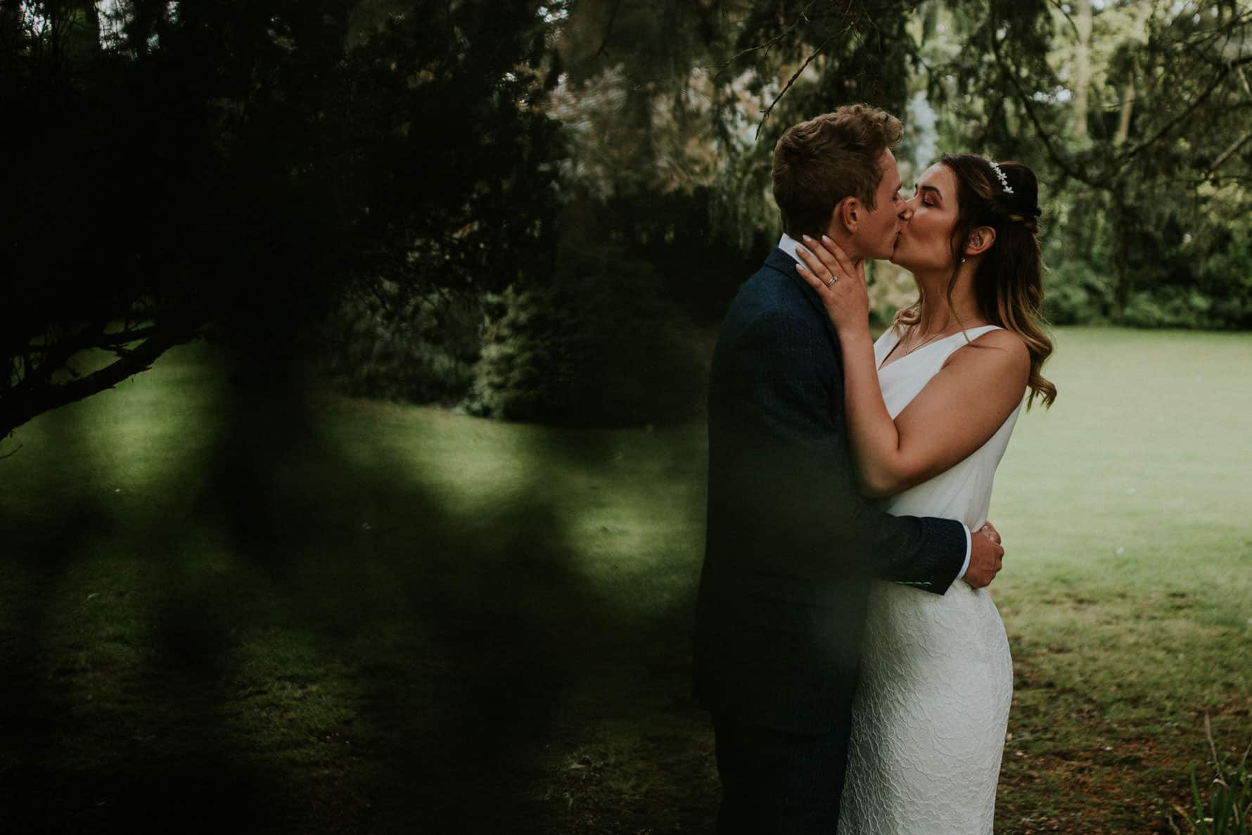 Bride and groom kissing during relaxed couple portraits