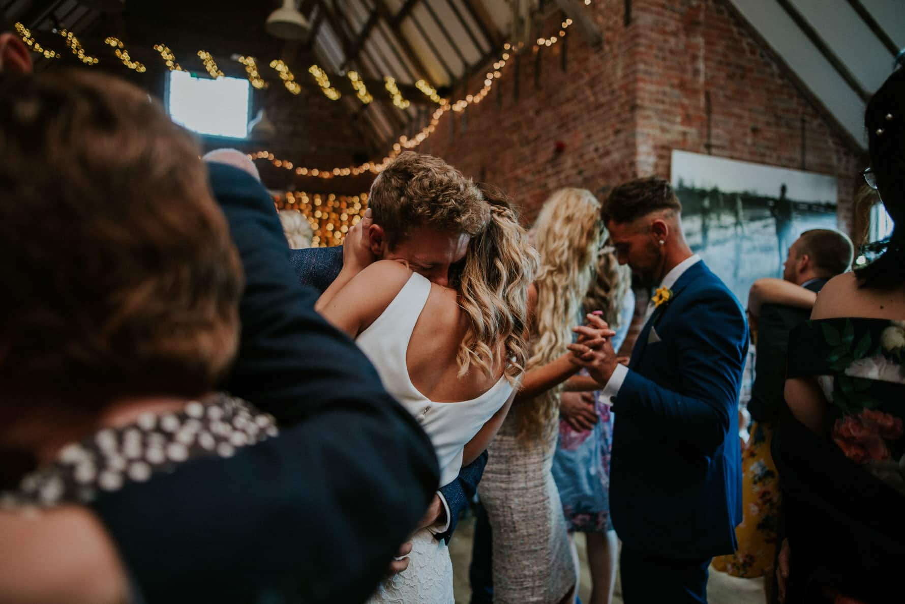 Bride and groom embracing on the dance floor