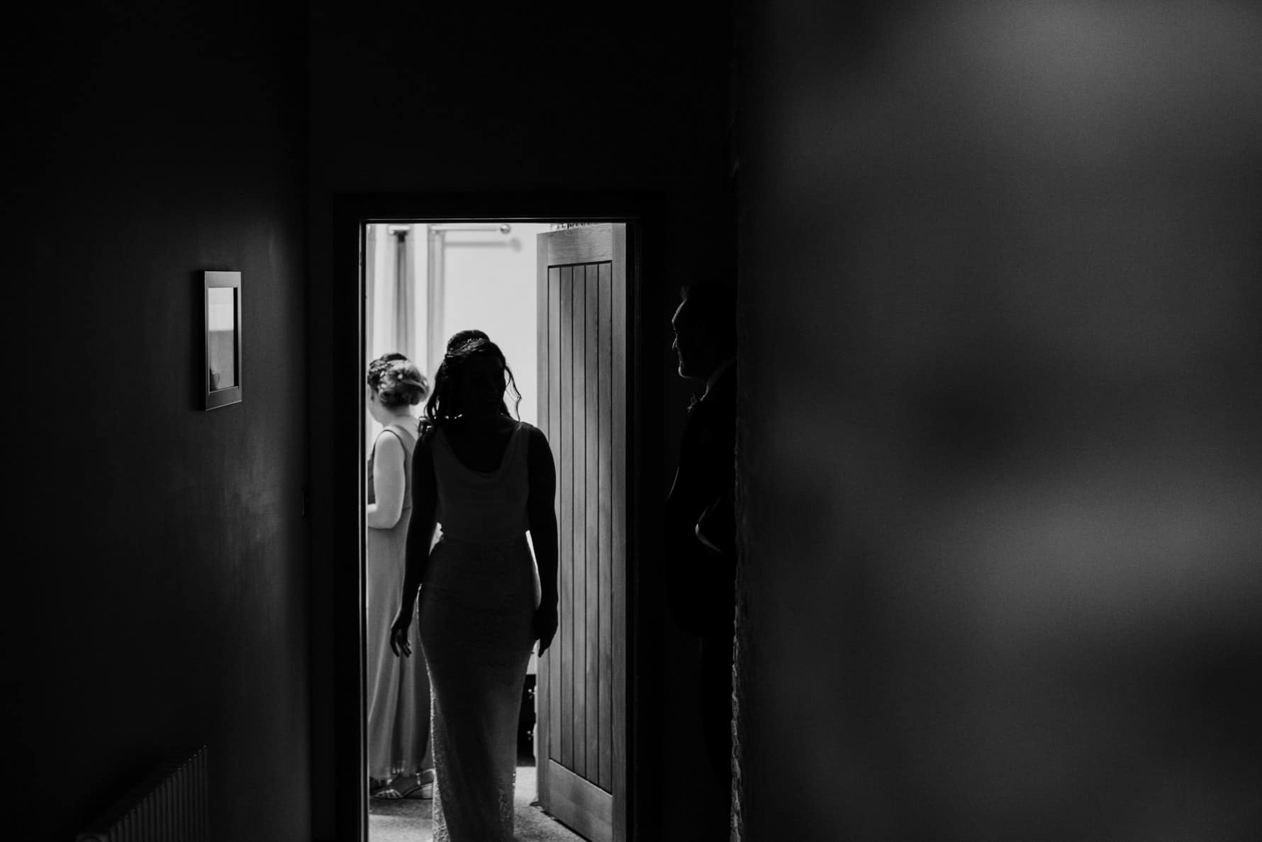Bride walking out of the prep room to her dad Boston wedding photographer