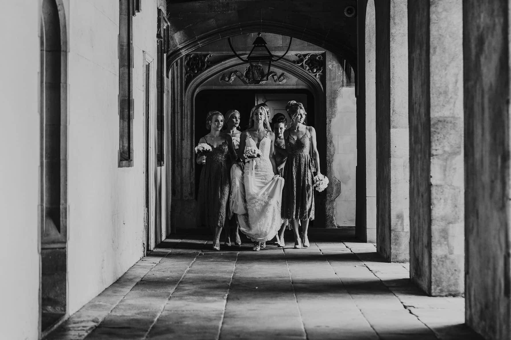 Bride and bridesmaids walking towards a wedding ceremony