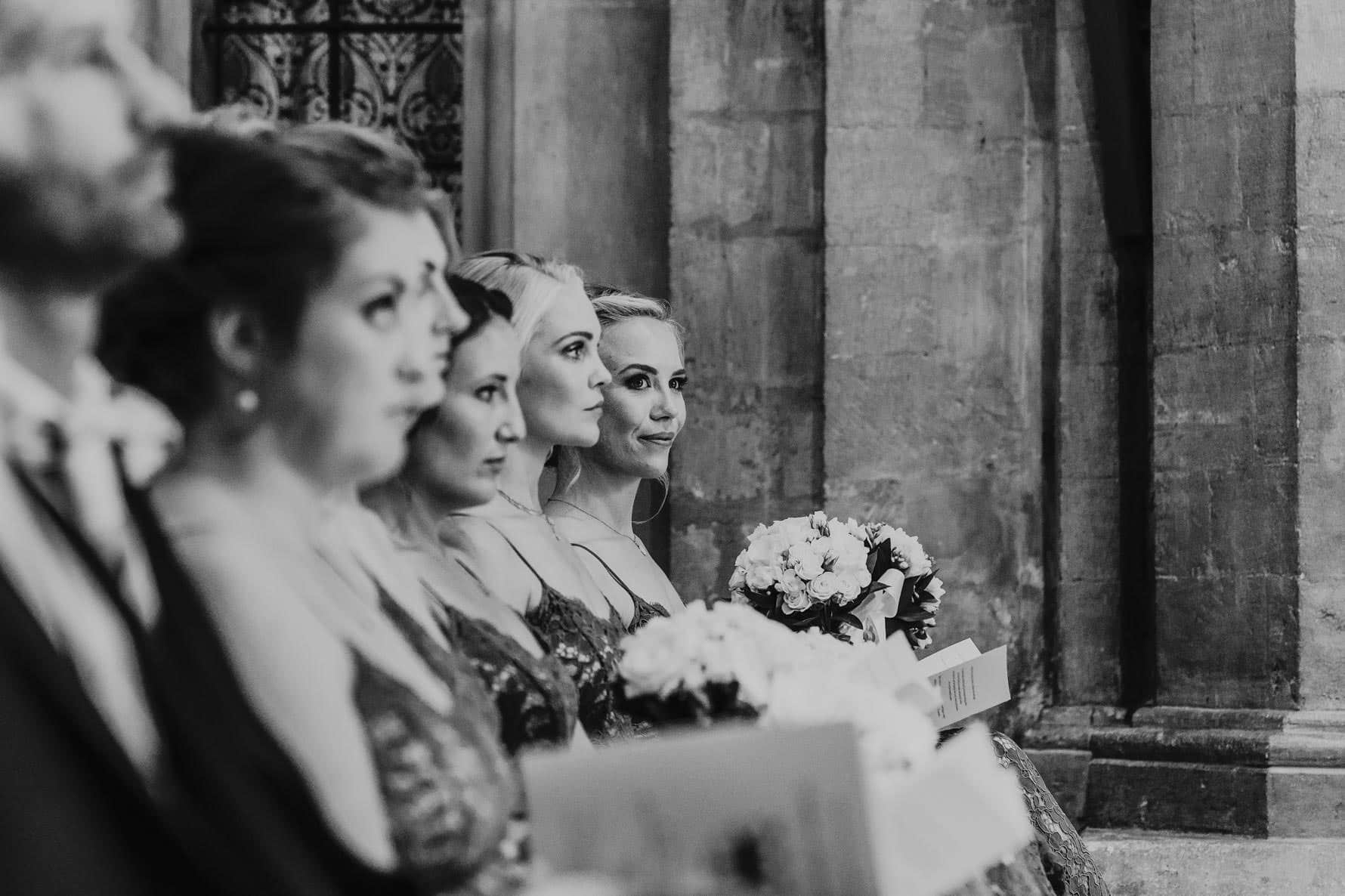 Bridesmaids looking on at the wedding ceremony
