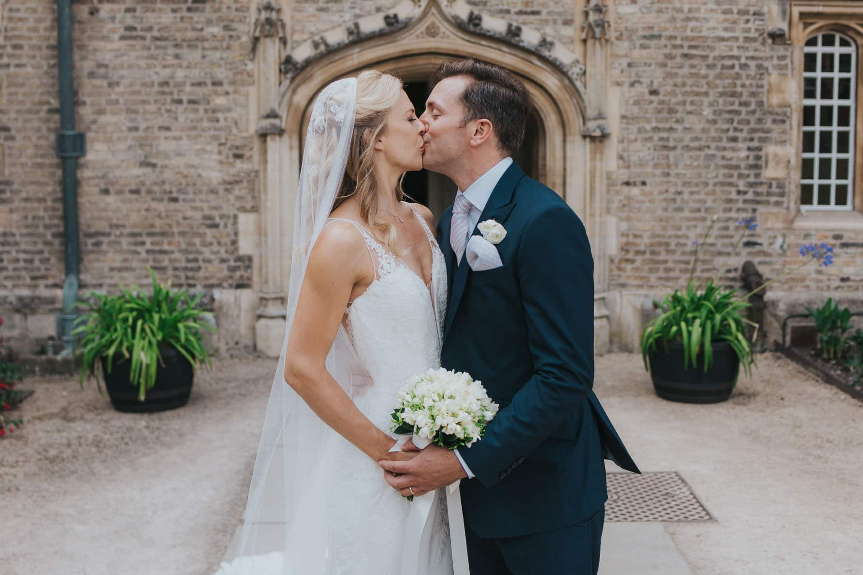 Bride and groom kissing for the first time