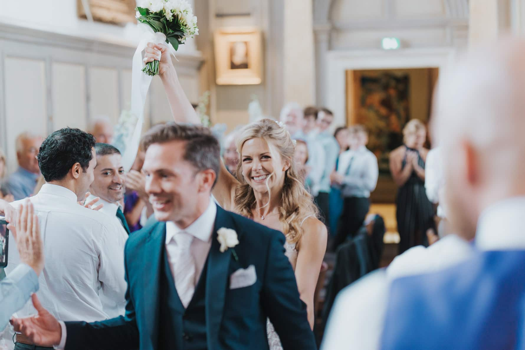 Bride and groom entering their wedding reception