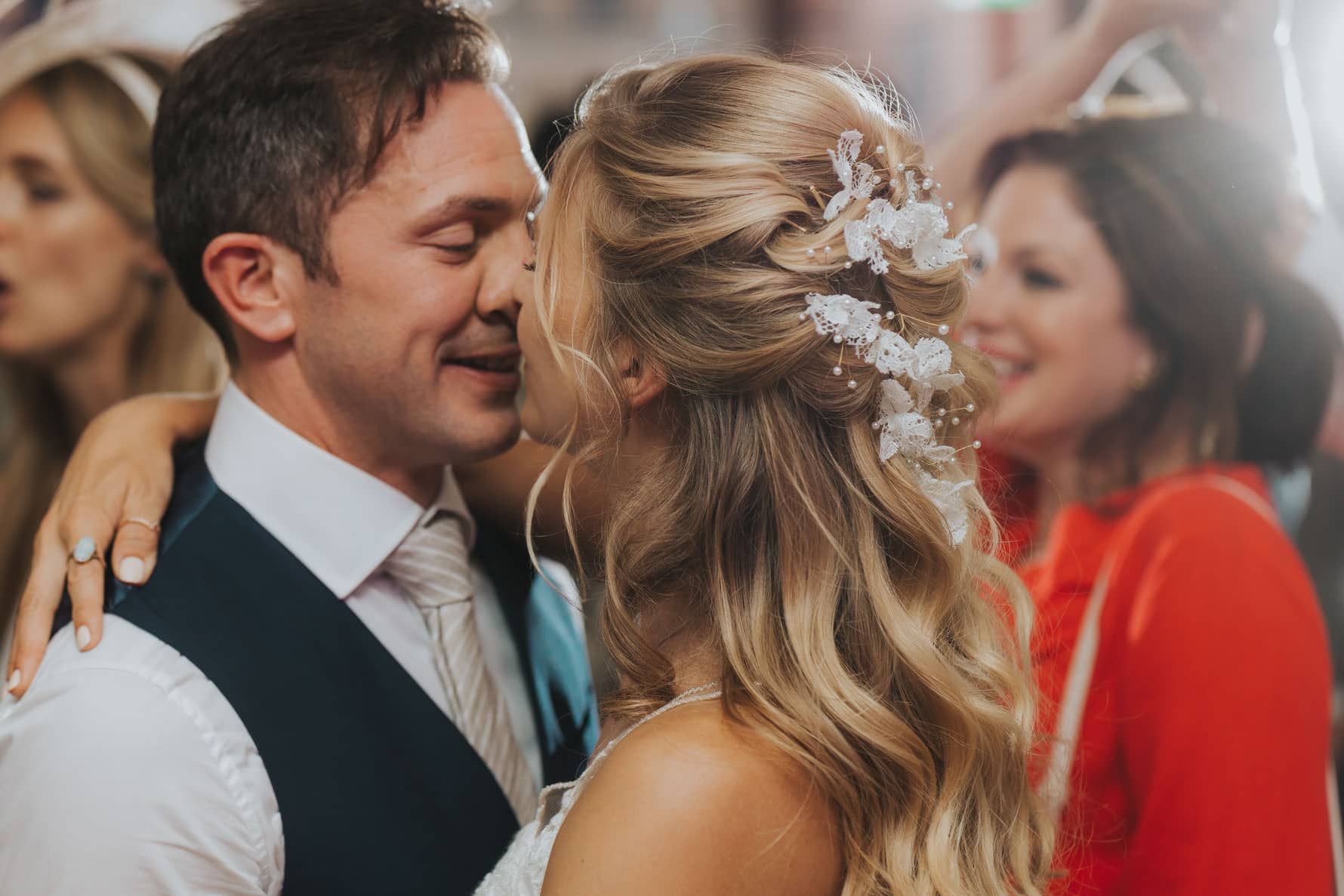 Bride and groom smushing noses during their first dance