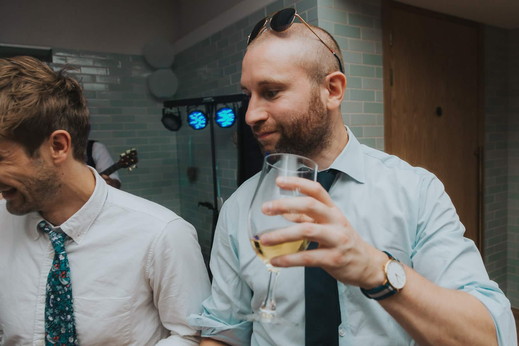 Wedding guest celebrating and drinking a pint of beer