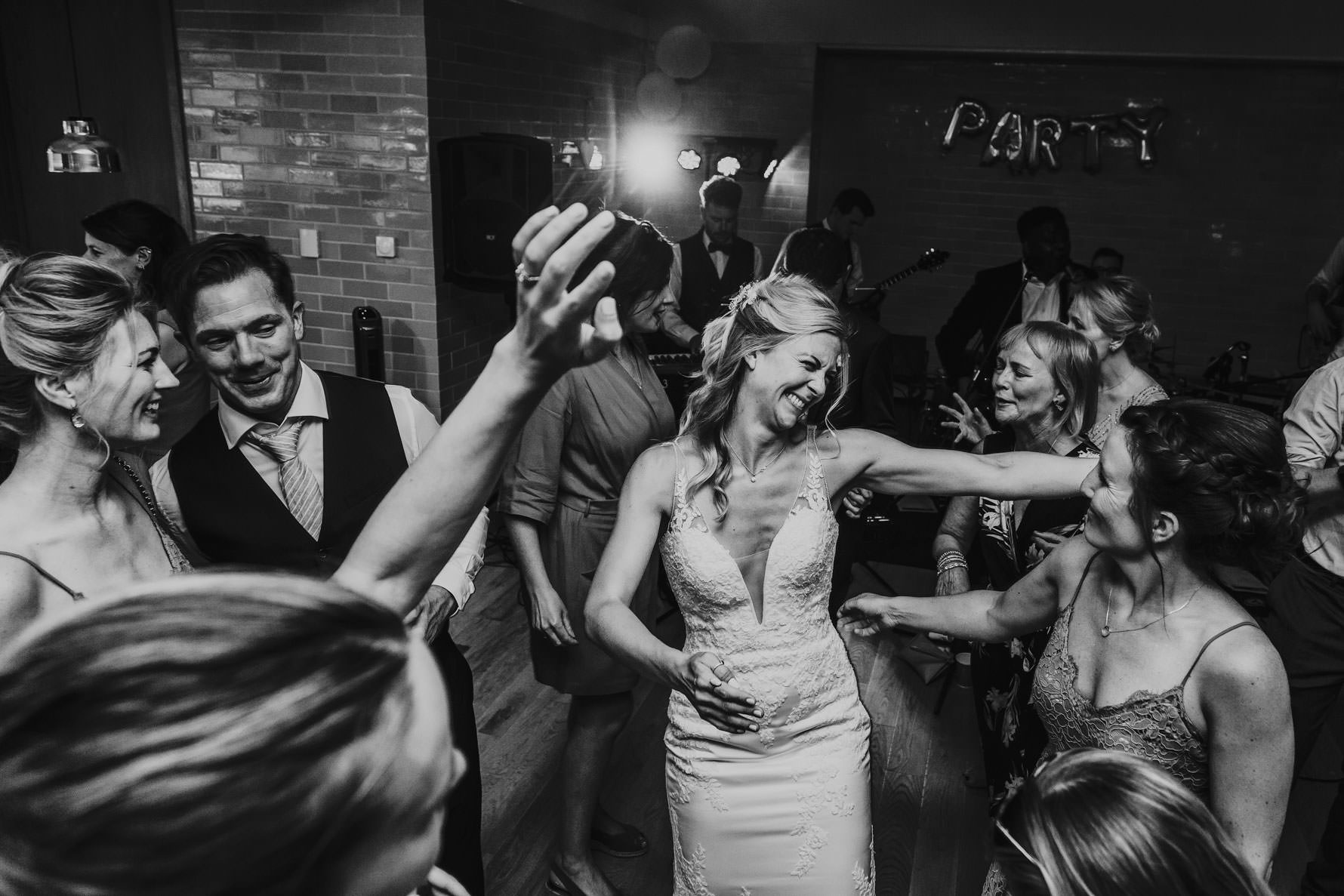 bride celebrating on the dance floor