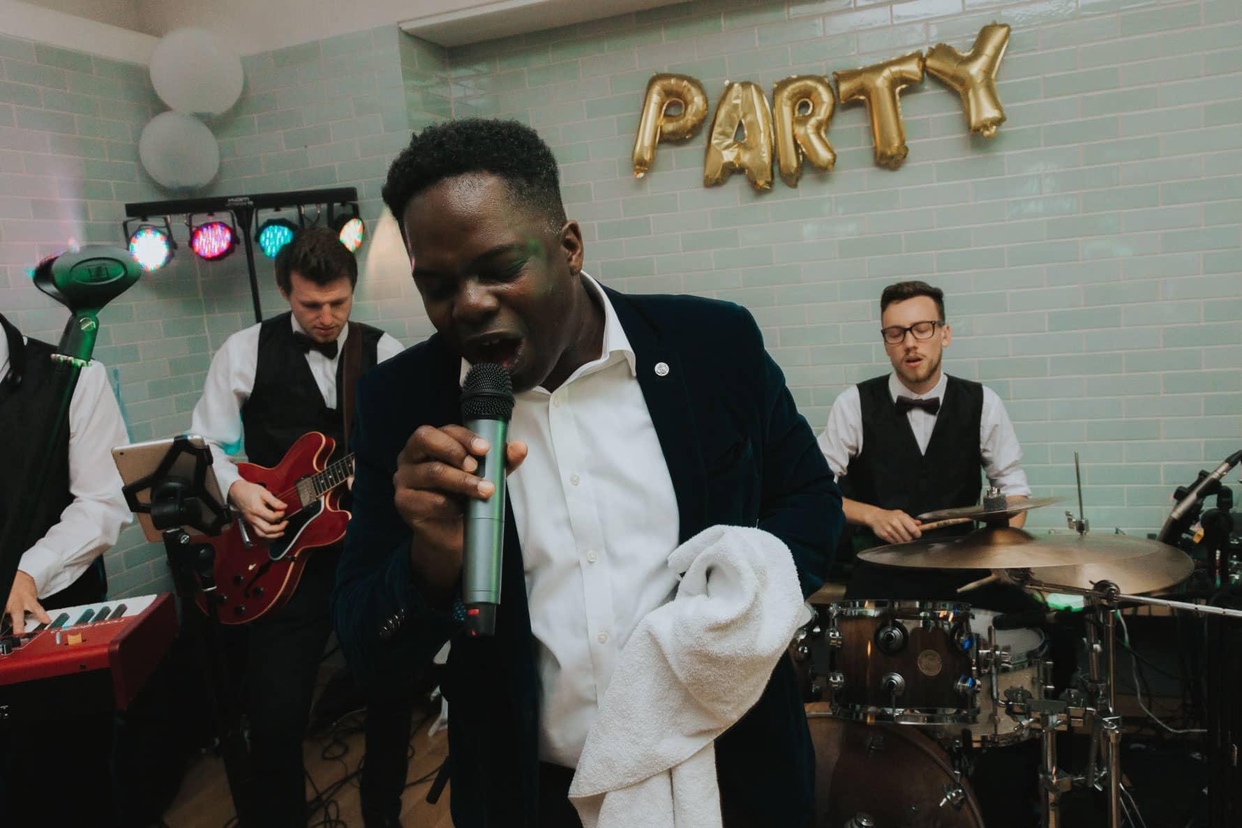 Lead singer of a wedding band at a wedding reception