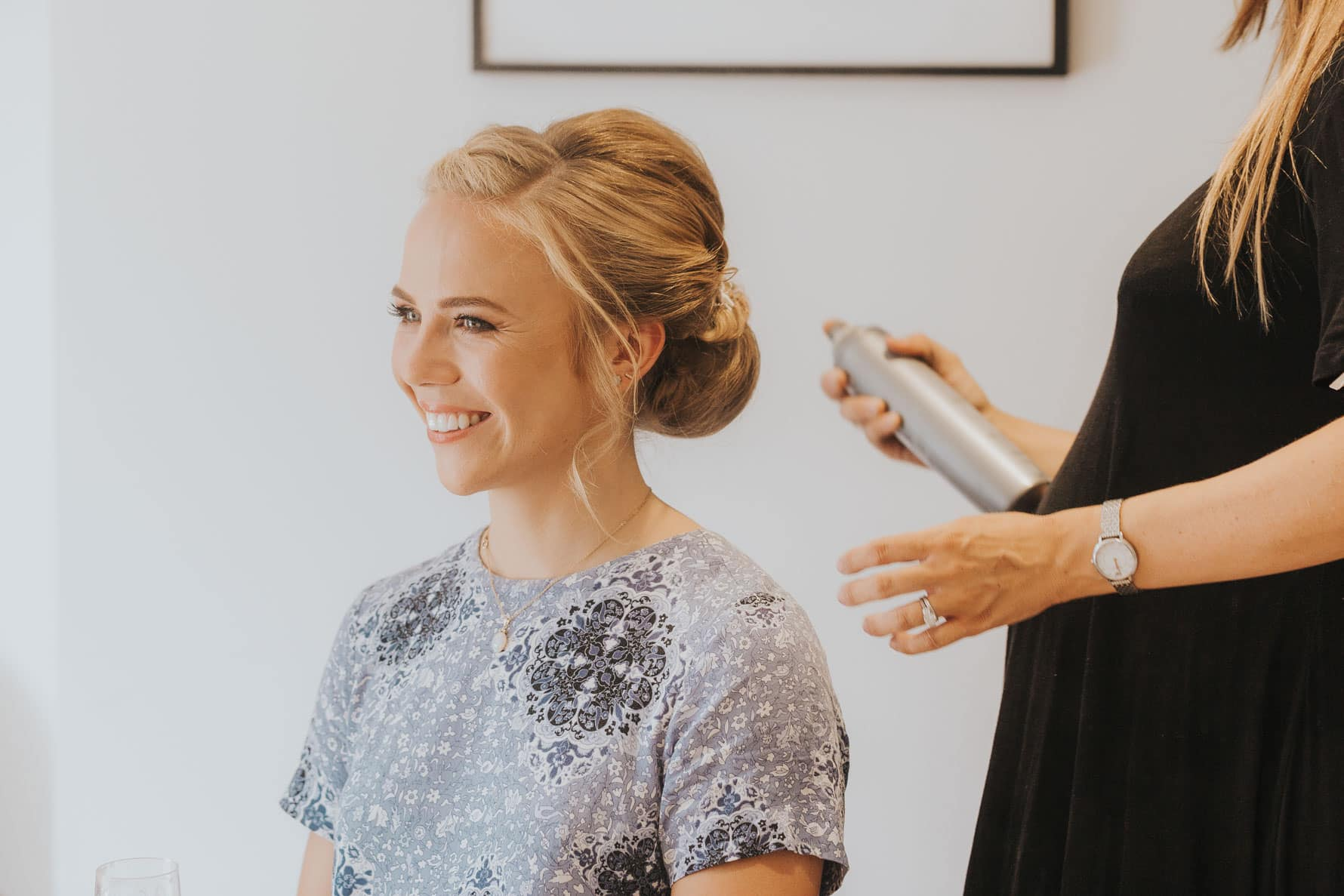 Bridesmaid having her hair finished off