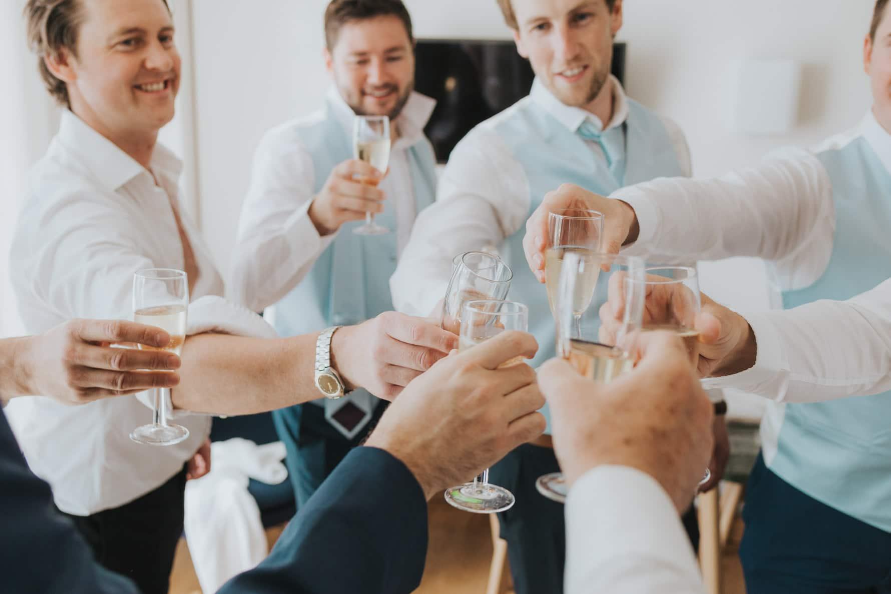 Groomsmen celebrating the morning of a cambridge wedding photographer