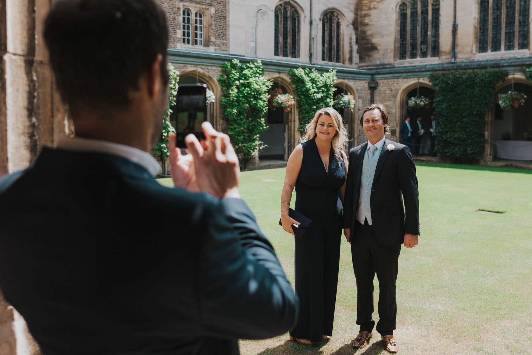 Wedding guests standing on a garden having their photo taken±