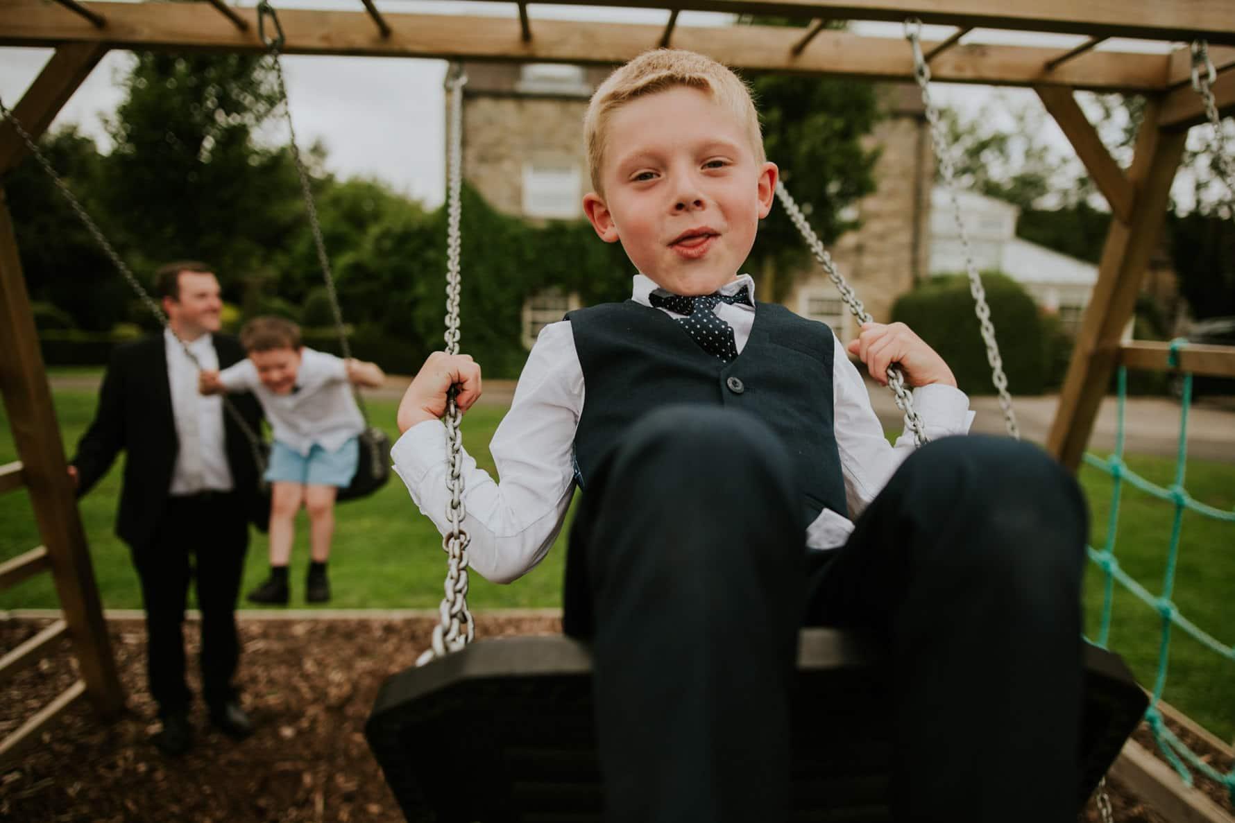 boy on a swing during a wedding reception