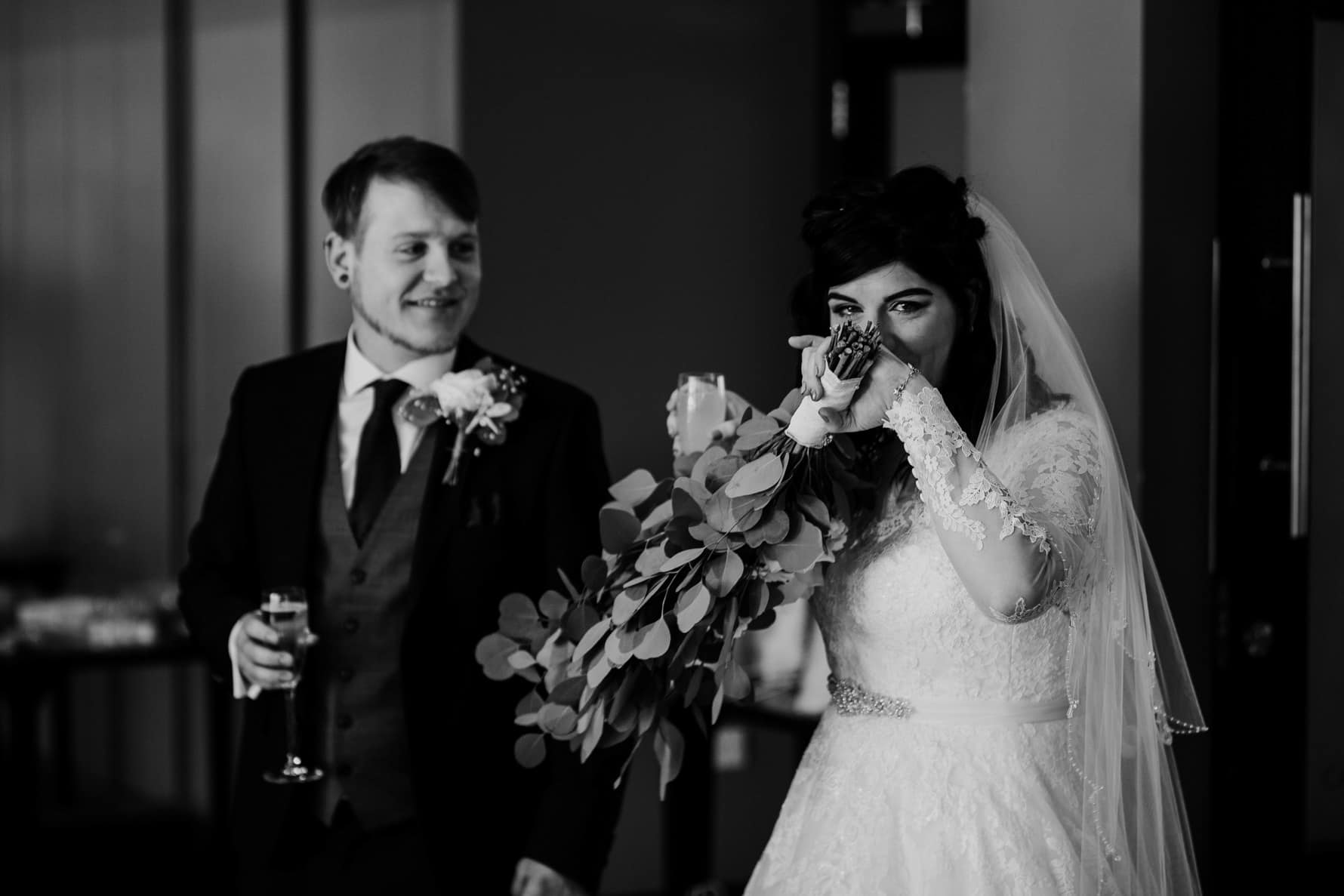 Bride crying after her wedding reception