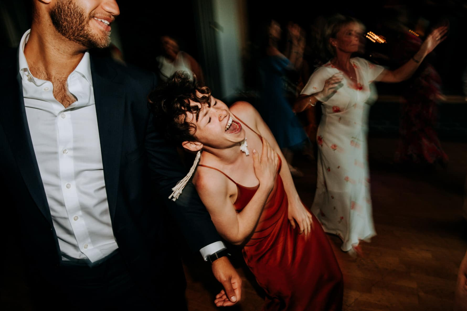 Lady on the dance floor at a wedding laughing