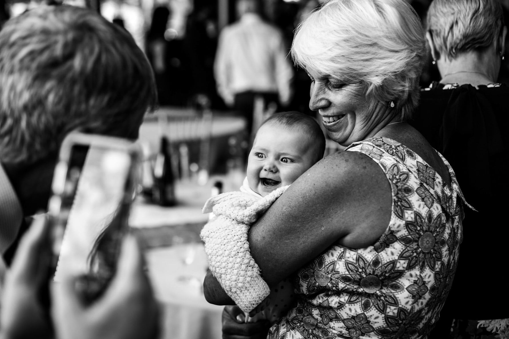 Lady holding a baby who is laughing