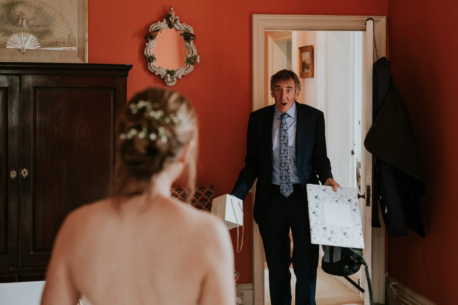 Father of the bride reacting to seeing his daughter