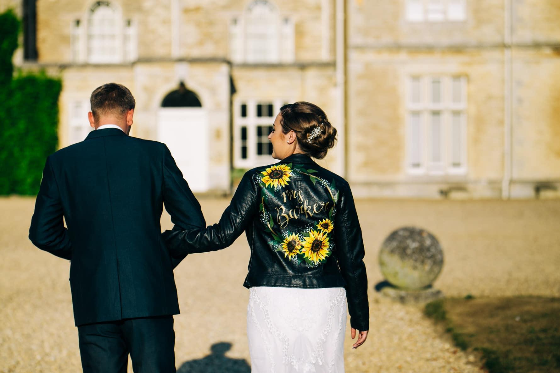 Bride and groom walking towards Exton Hall