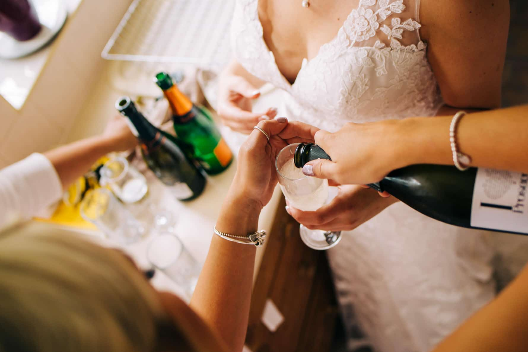 bridesmaids pouring a glass of wine