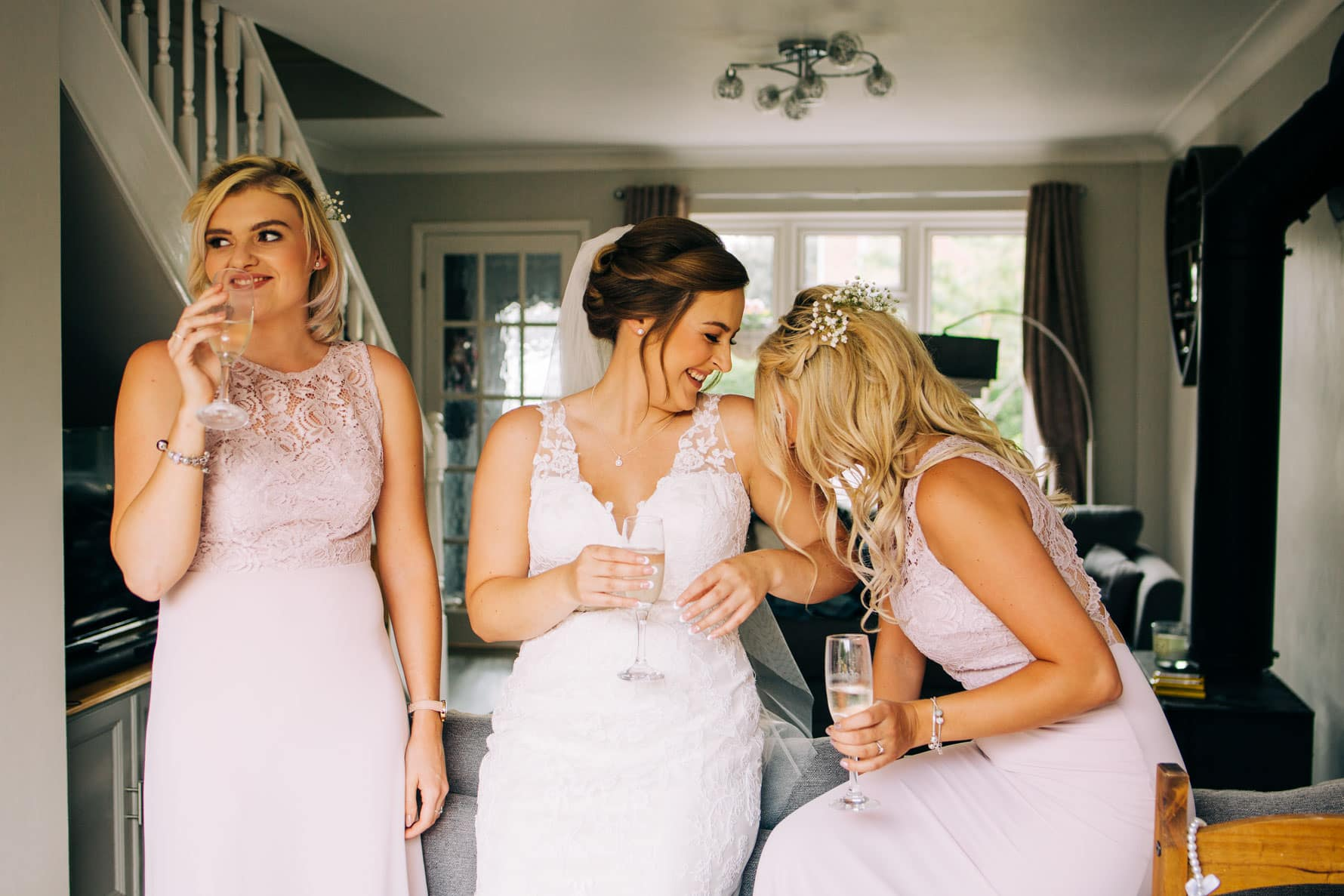 Bridesmaids laughing with each other before a wedding